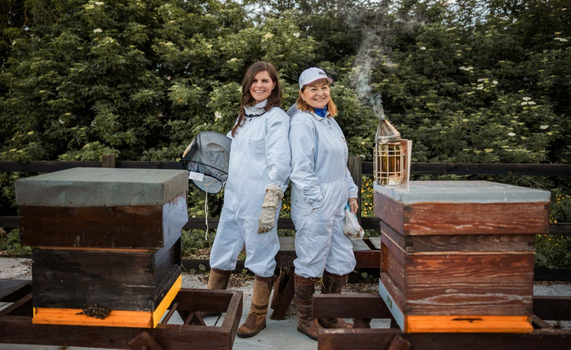 Sally Anne Cooney, left, with her mother Marie Cooney, with some of the beehives at the family's lands in Kilmessan, Co Meath.  The enterprising mother and daughter are taking on the spirit world with Silks Gin – named after the jockeys' silks worn at the famous Bellewstown racecourse in Meath beside the family's Boann Distillery.