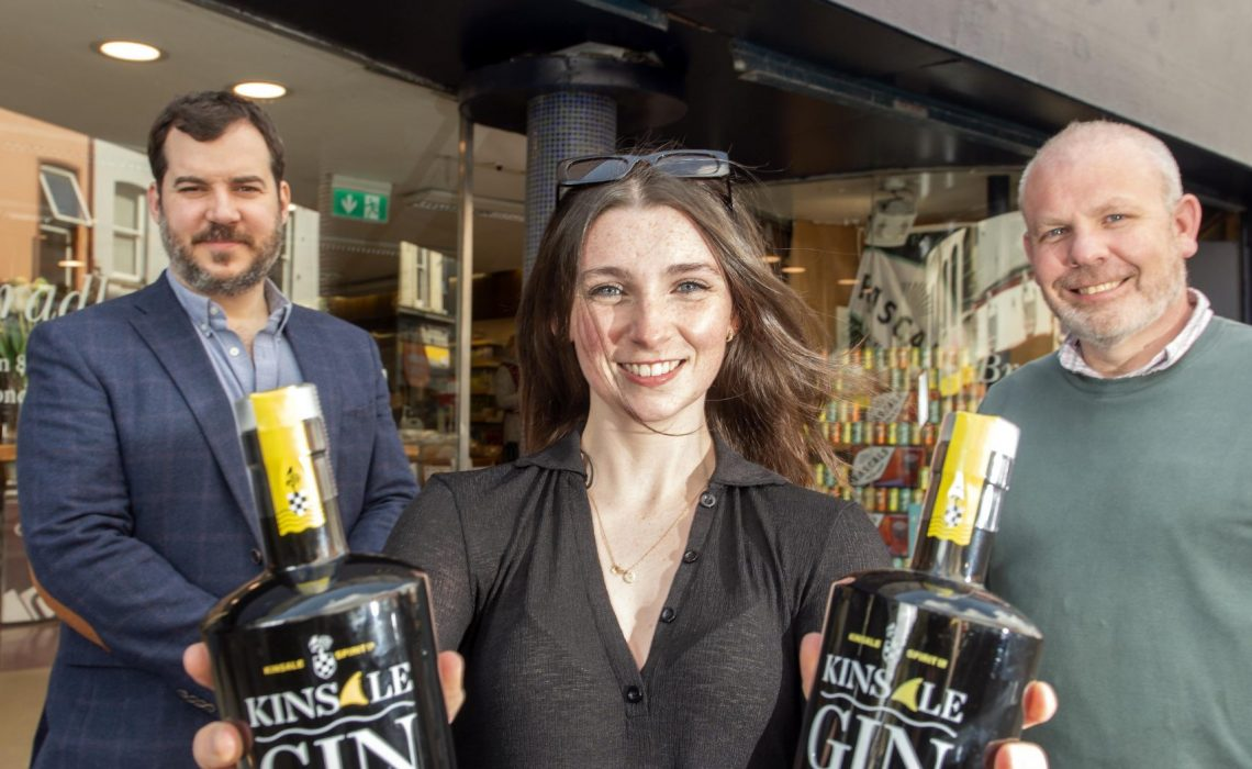 Provision 260421 Pictured: Ernest Cantillon from Kinsale Spirit Co., shopper Claire McLaughlin from Blackrock, and Michael Creedon of Bradley's, at Bradley's Specialist Off-Licence and Foodstore, North Main Street, Cork. Claire recently bought the 100,000th bottle of Kinsale Gin, serendipitously in the first store that stocked the drink when it hit the shelves in 2016. As a thank you, Kinsale Spirit Co are treating Claire to a weekend away in Kinsale, where she will be spoiled with everything that makes Kinsale so special to them – a meal from Fishy Fishy, chocolates from Koko's, and of course, the small batch, premium Kinsale Gin.  Pic: Michael Mac Sweeney/Provision
